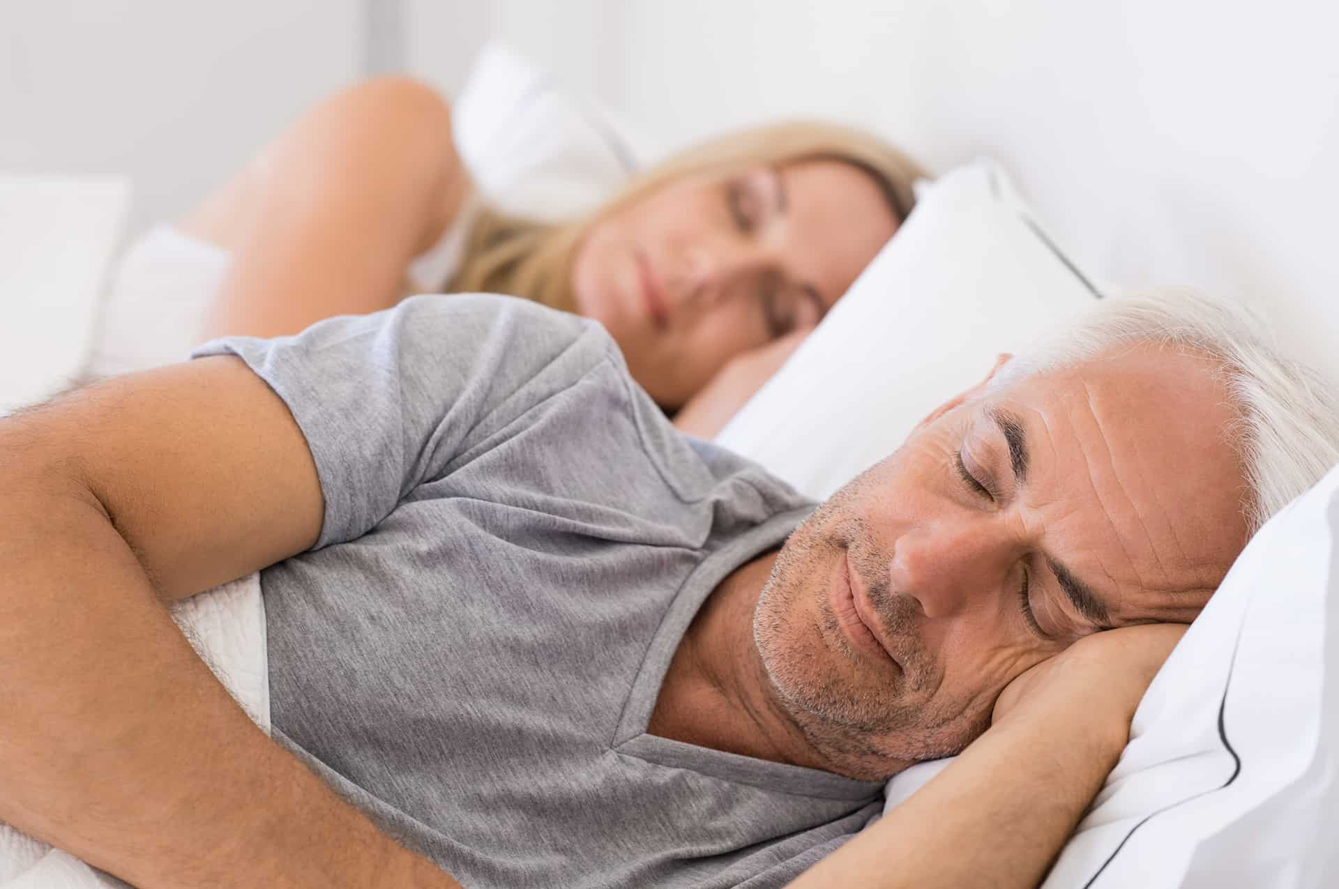 Couple sleeping peacefully in bed