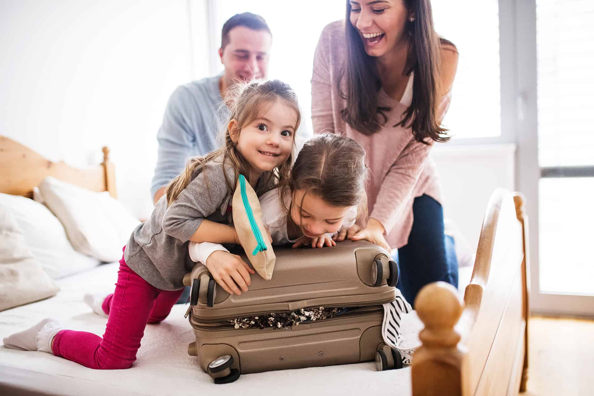 Young family packing for travel.