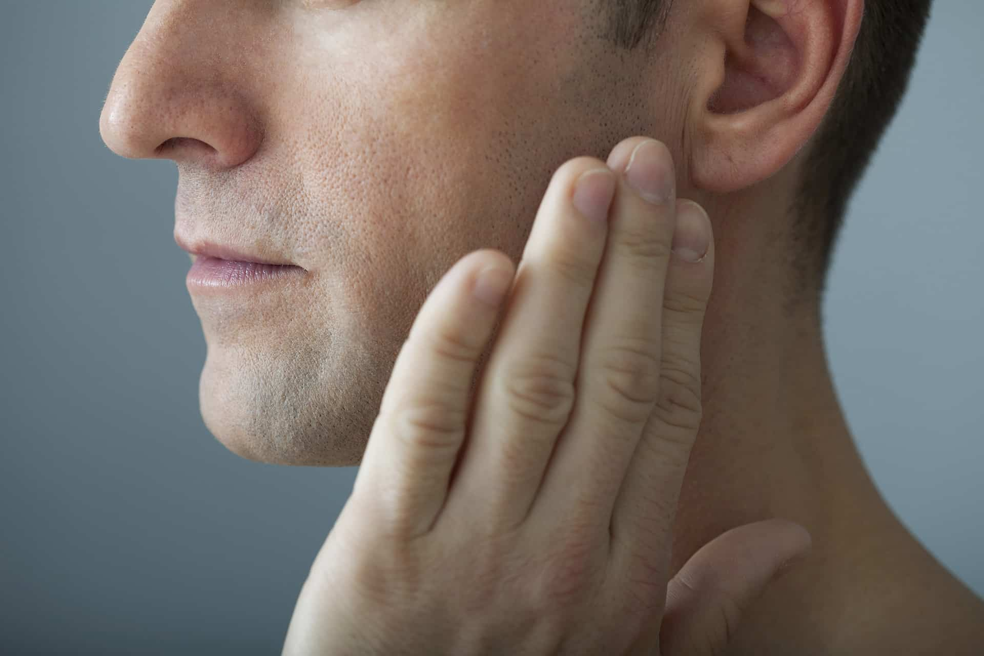 Man with mild jaw pain